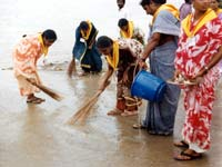 CLEANING THE BATHING GHATS