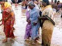 HELPING THE AGED TAKE A HOLY DIP