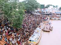 PILGRIMS THRONG THE BANKS OF HOLY GODAVARI
